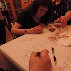William Simpson croque Bill Reinhold, tandis que Linda Lessmann nous montre ses talents de dessinatrice
